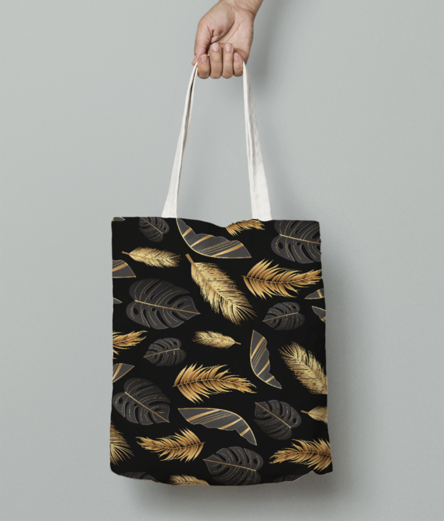 Black golden feathers tote bag front