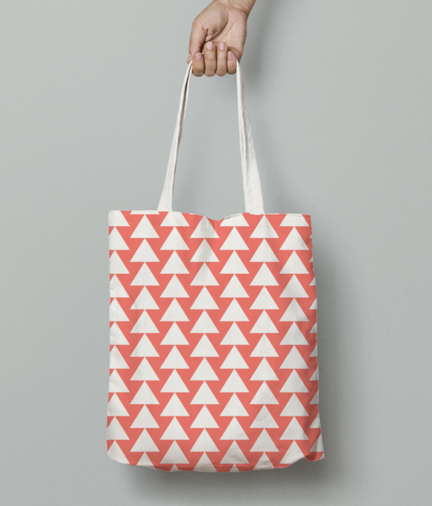 White triangle living coral pattern tote bag front