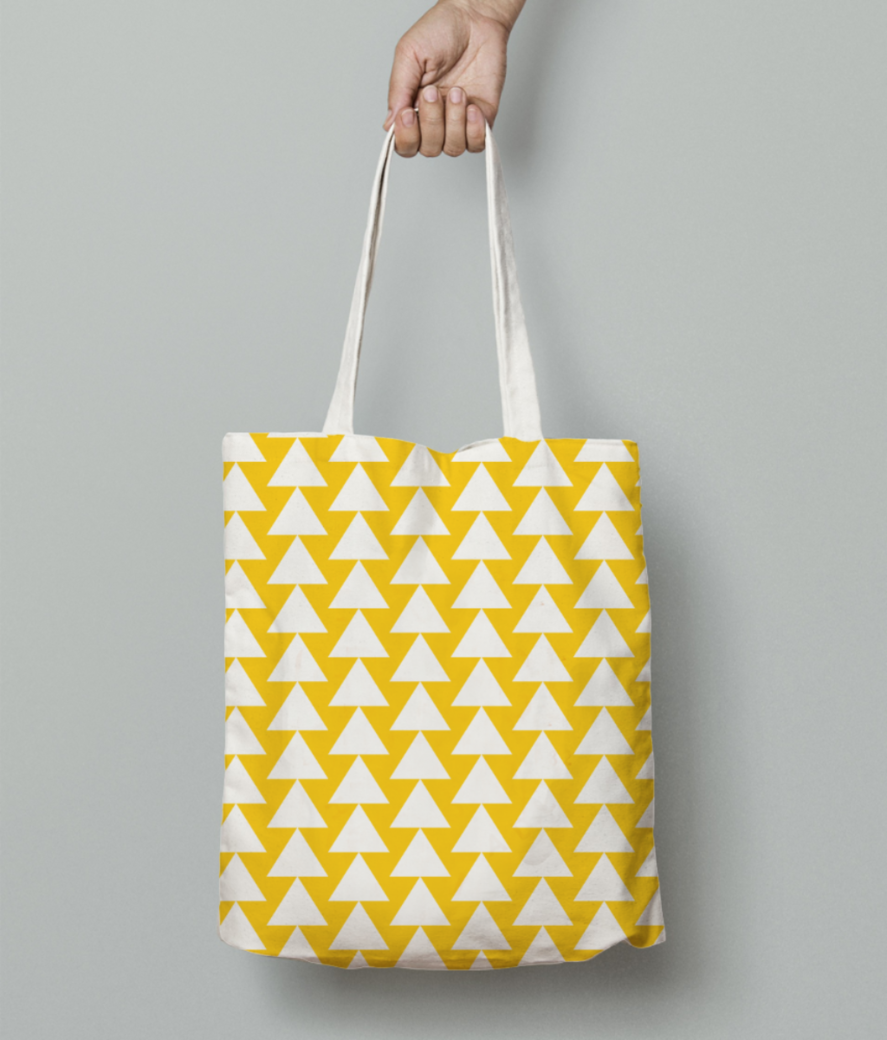 Yellow white triangle pattern tote bag front