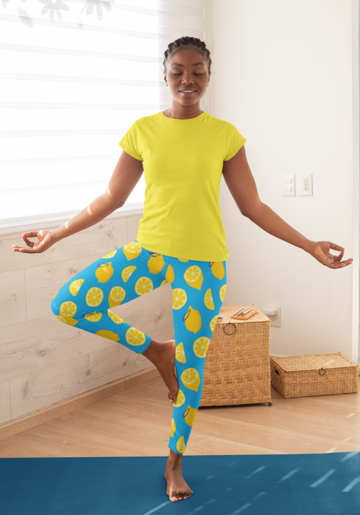 T shirt mockup of a woman wearing leggings and doing a tree pose 31089